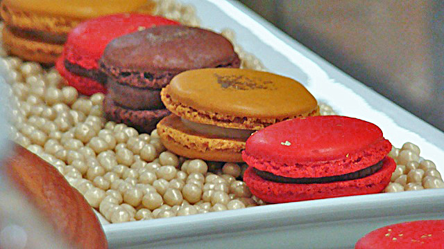 A variety of macarons on chocolate pearls