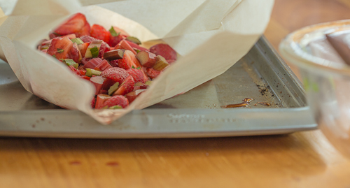 The strawberry-rhubarb en papillote is in the bag, heading for the oven -- The Messy Baker