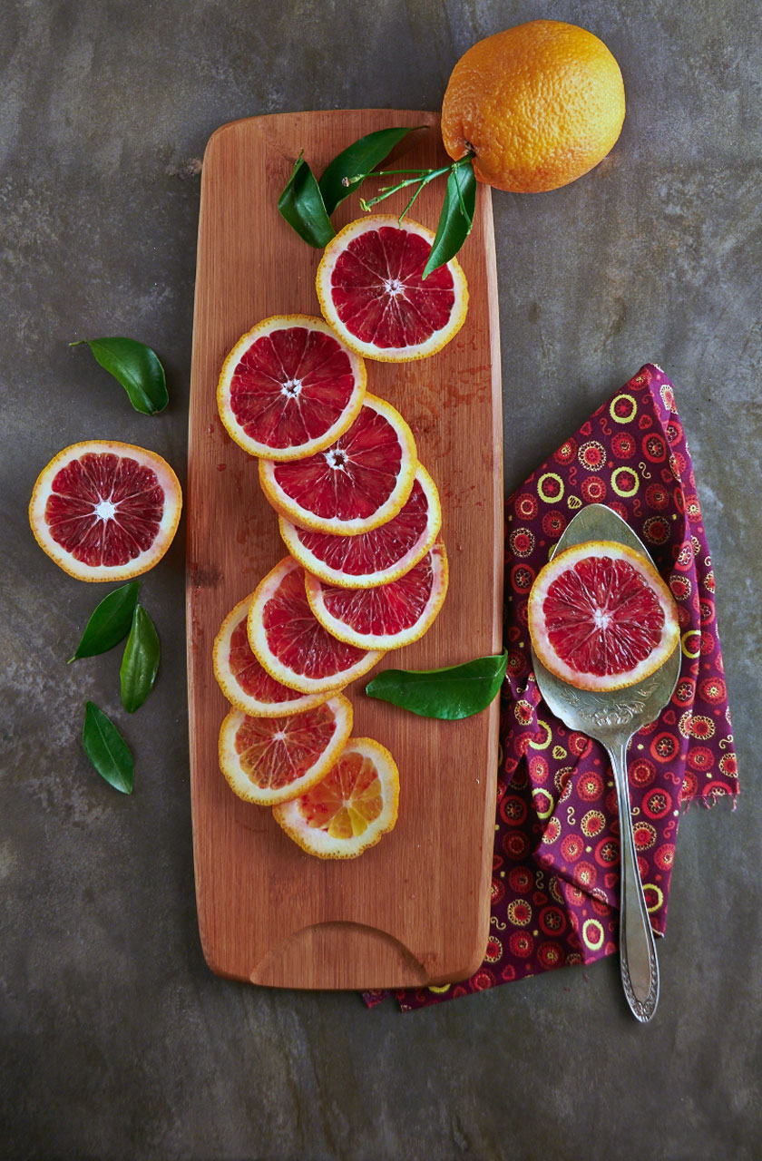 Rings of blood oranges slices to show the contrast of skin and fruit. By The Messy Baker.