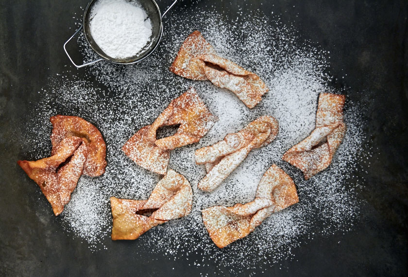 Crostoli dusted with icing sugar by The Messy Baker
