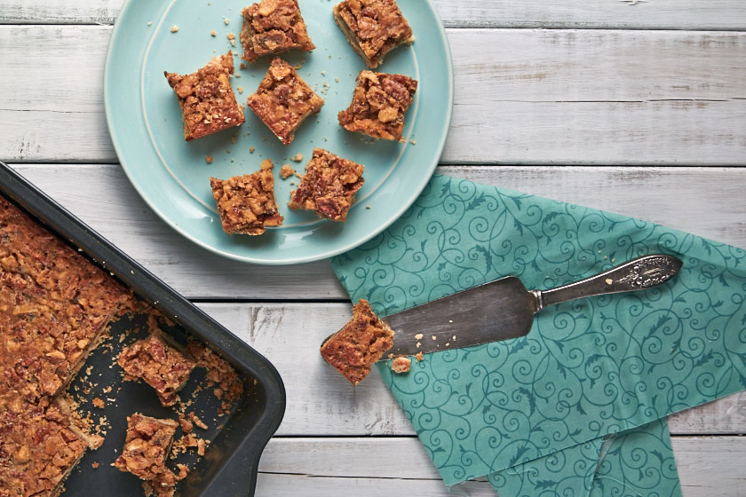 Maple Nut Squares are topped with a mix of nuts and maple syrup.