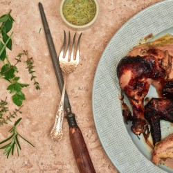 Herbed rotisserie chicken with basting sauce.