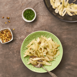 Pan-roasted fennel with pistachios and fennel leaves